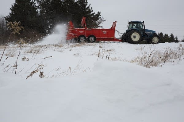 Wayne Fredrickson spreads artificial snow on trails.
