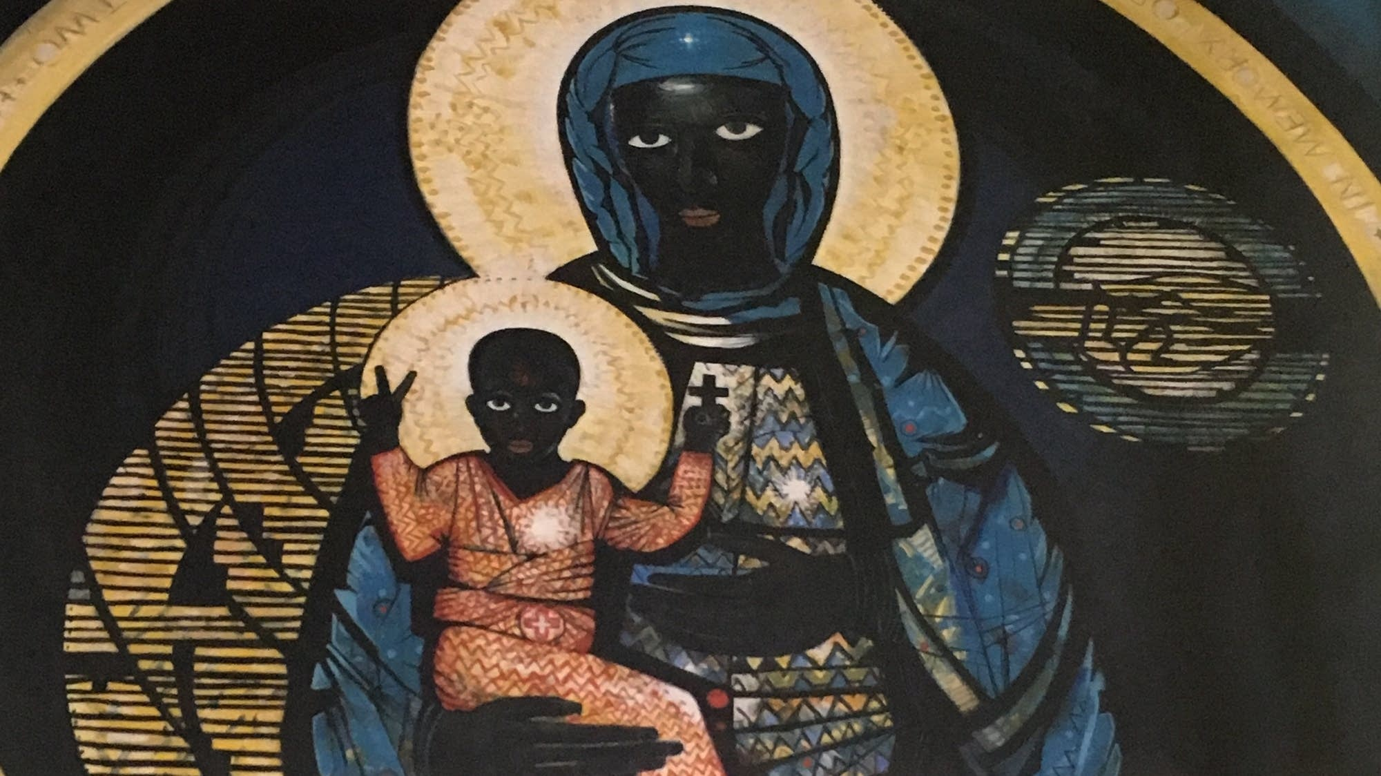 The black Madonna on the wall of the Regina Mundi Church in Soweto.