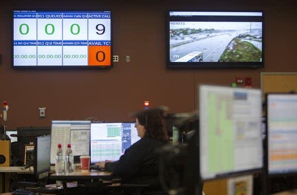 Monitors on a wall.