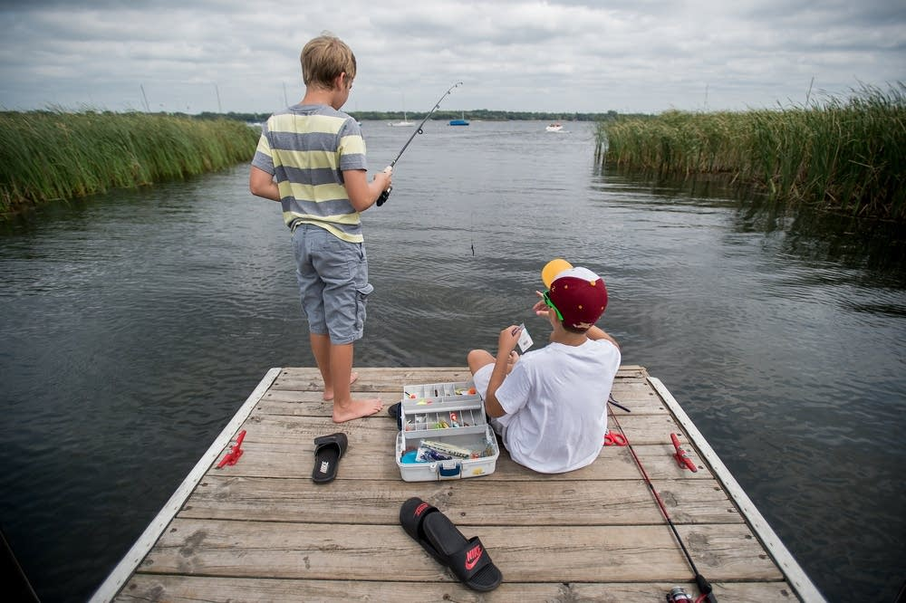 Dominick Schmit-DeRosa and Noah Engen fishing.