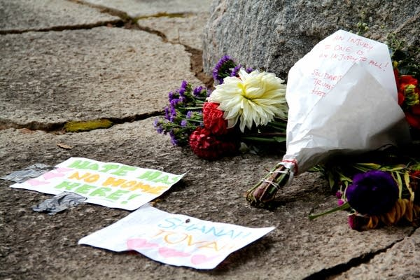 Flowers are left at the site of anti-Jewish and pro-Donald Trump graffiti.