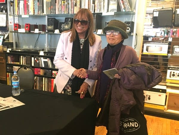 Sharon Nelson (left) meets with a fan at the Electric Fetus.