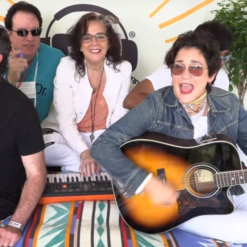 The Revolution perform 'Raspberry Beret' in bed, to fight cancer.