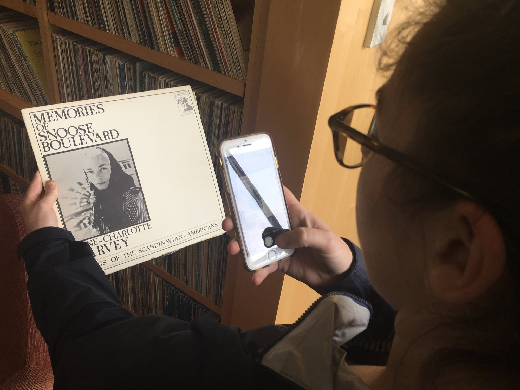 The Current's Jesse Wiza tries to scan her favorite album cover.