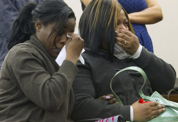 Jamar Clark's sisters watch a video.