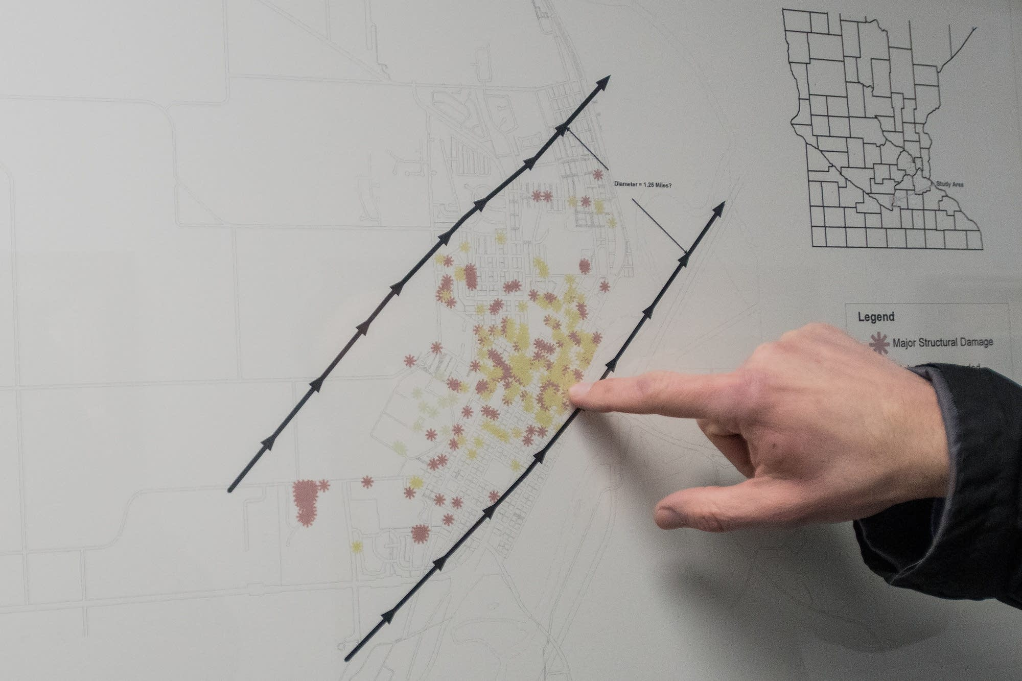 Prafke points out the downtown area on a map of the path of the tornado.
