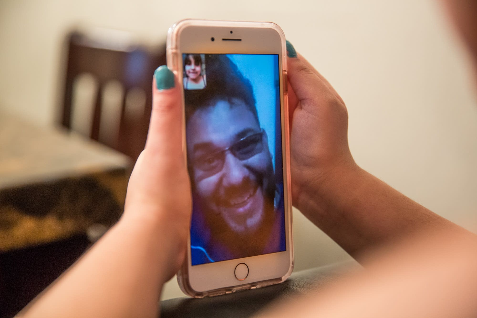 Hasanain video chats with his daughter.