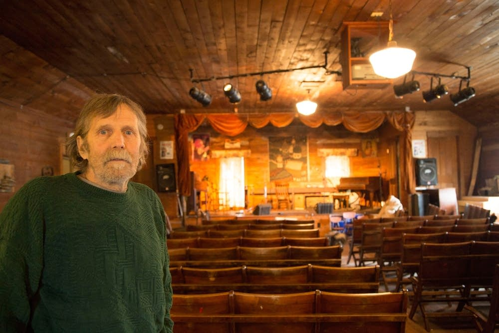 Steve Schwen stands Oak Center General Store's upper room, which serves as a live-music venue.