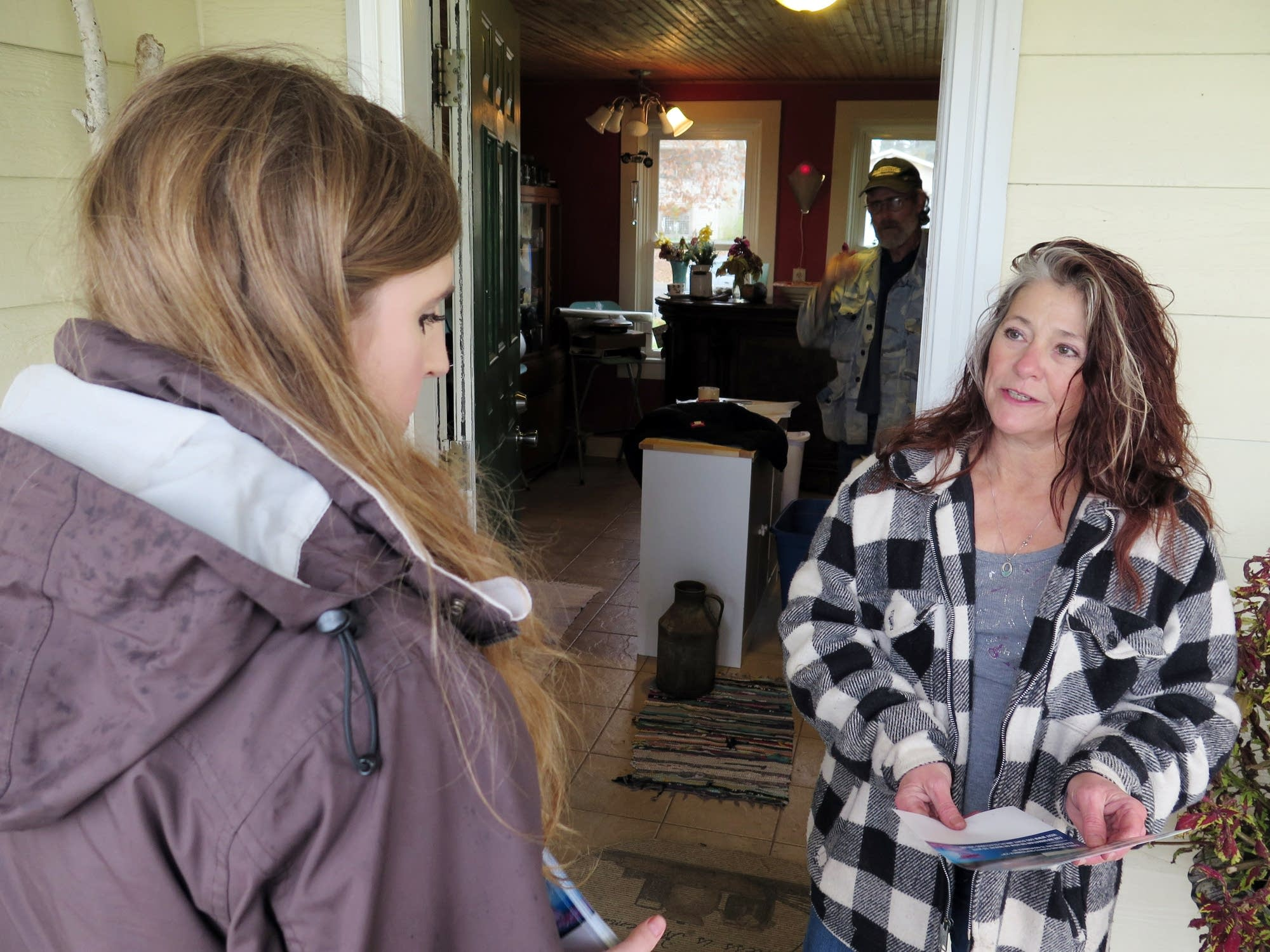 Canvasser Mary Silverthorn, left, talks with Nancy Semmer.