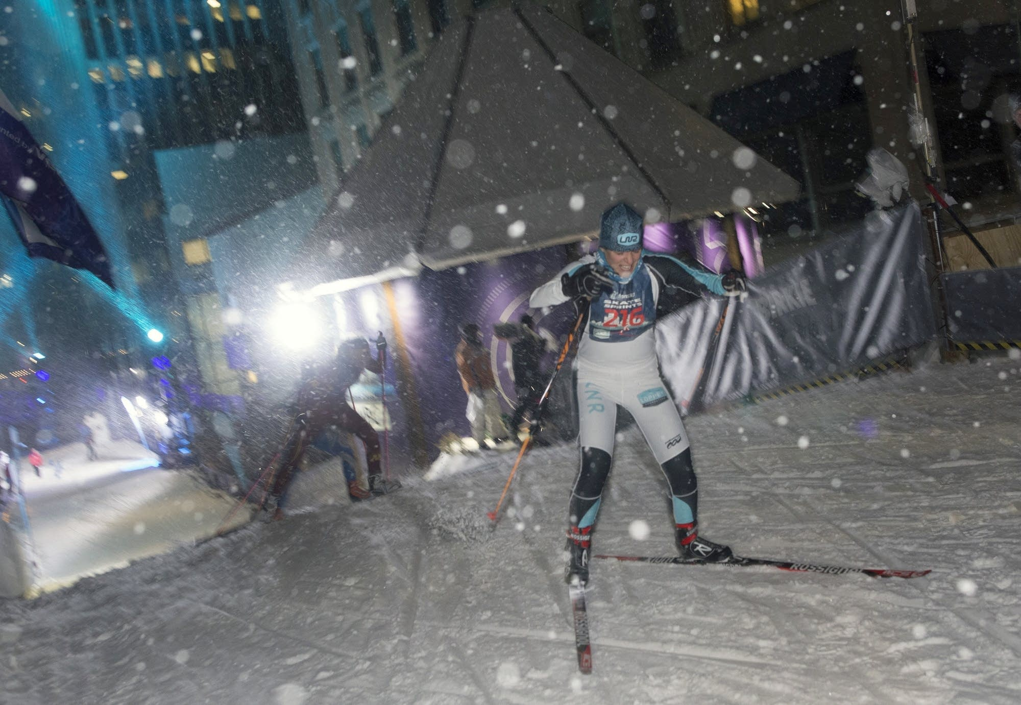 Nordic skiers competing in the loppet sprints climbed the hill.