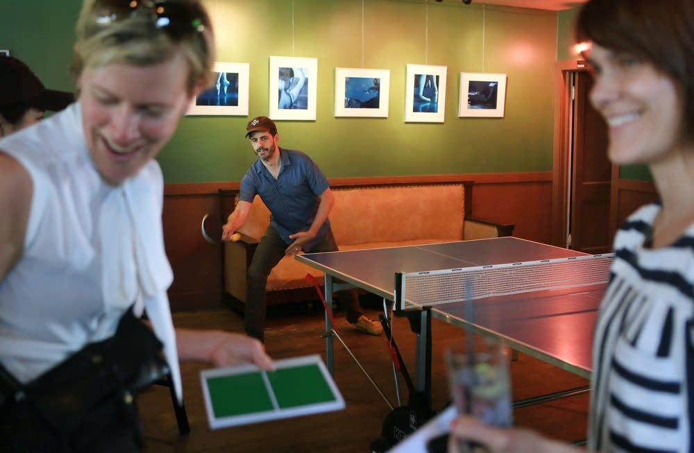 Alec Soth plays ping pong at the Dubliner Pub.