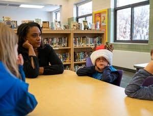 Angela Davis asks kids about gifts. 6