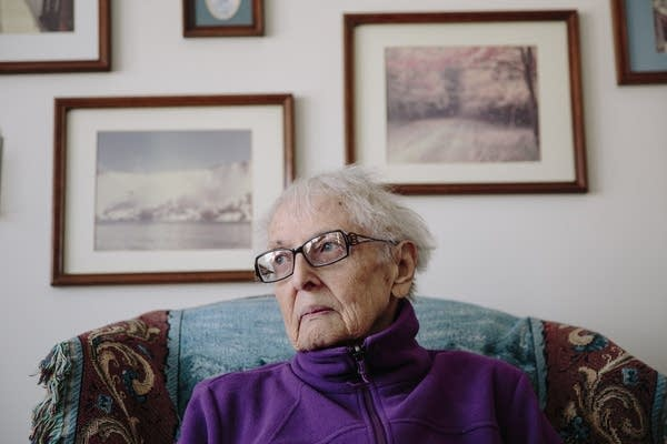Eighty-year-old Elaine Lange sits in her home in Brooklyn Center, Minn.