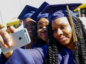 Diamond Syaz takes a selfie before commencement.