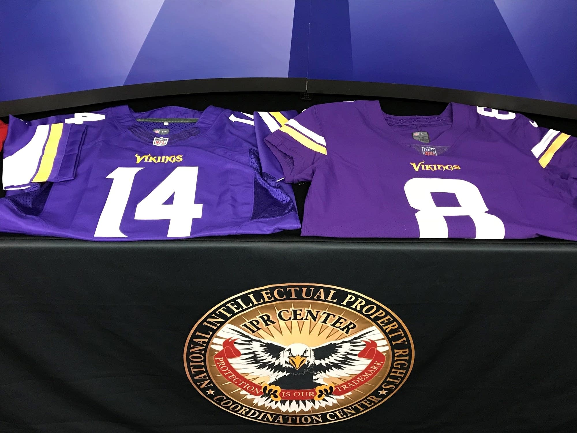 1e6f9f8e6 Federal officials display a counterfeit and a real jersey.