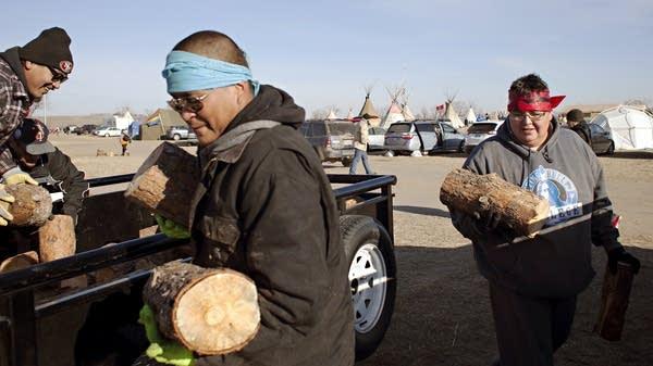 Red Lake members help prepare for winter.