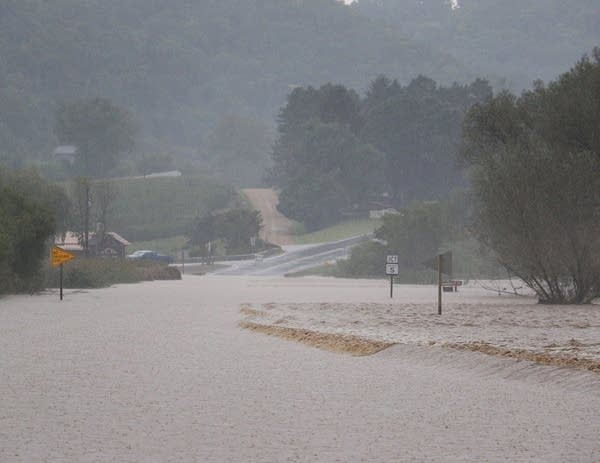 State Highway 56 is covered by floodwaters.