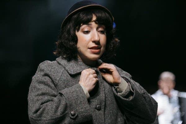 Miriam Schwartz, playing Chana, adjusts her costume