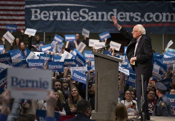 Sen. Bernie Sanders waves at his supporters.