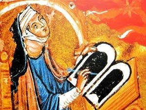 Hildegard von Bingen composing at her desk.