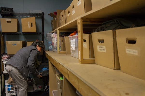 A volunteer checks the back room to help a guest.