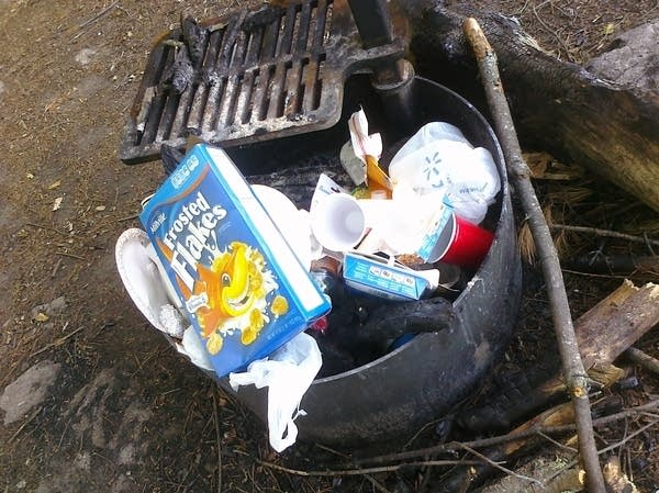 A pile of trash on a campsite of Voyageurs National Park