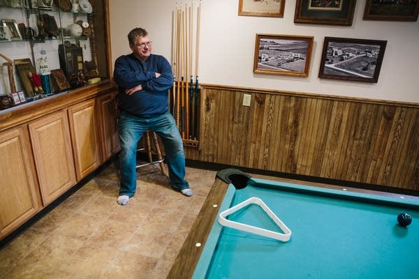 """Bob Worth sits in his """"man cave."""""""
