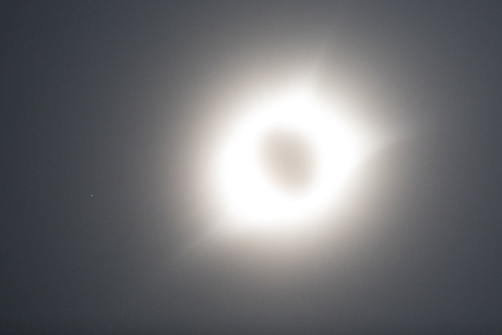 The star Regulus can be seen just to the left of the eclipse.