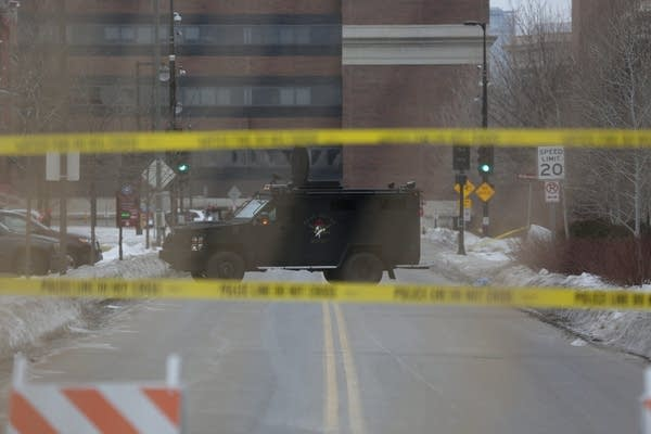 Police taking action in U hotel standoff, fire tear gas