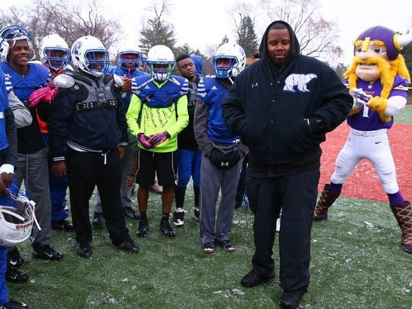 North head football coach Charles Adams, Jr., right.
