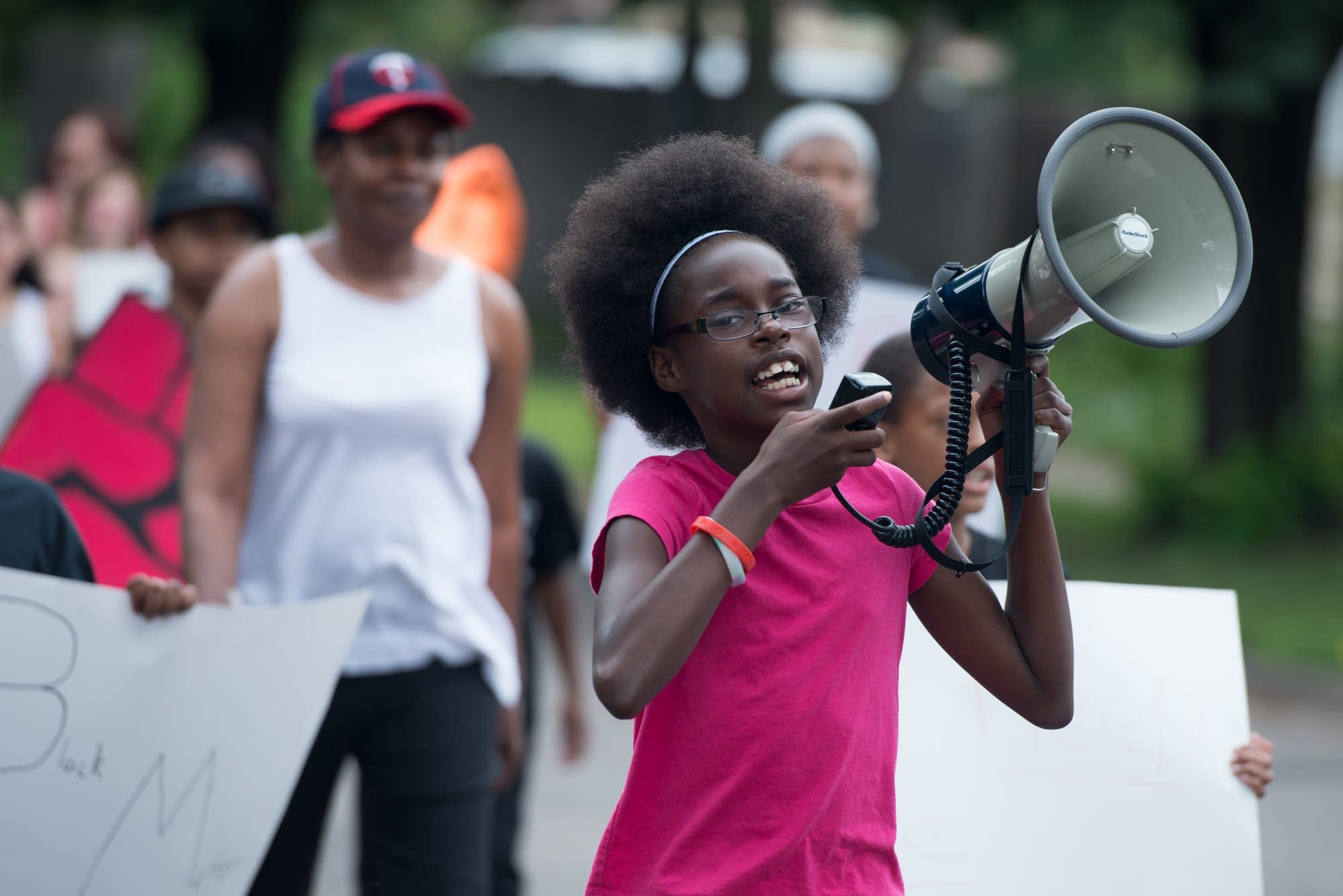 Kamaria Milton, 11, of St. Paul, leads the crowd.