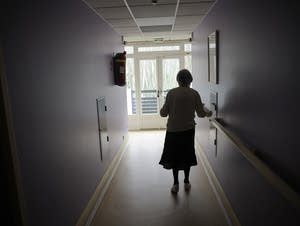 A woman, suffering from Alzheimer's