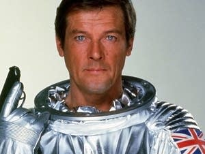 Roger Moore in character as James Bond