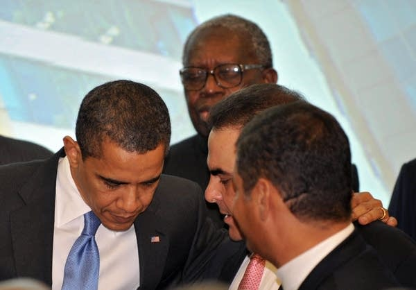 Barack Obama listens to South American leaders