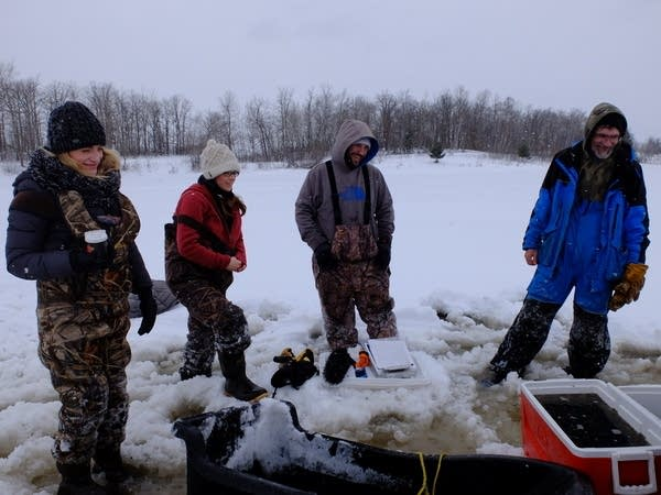 The crew take a breather while stocking a wetland.