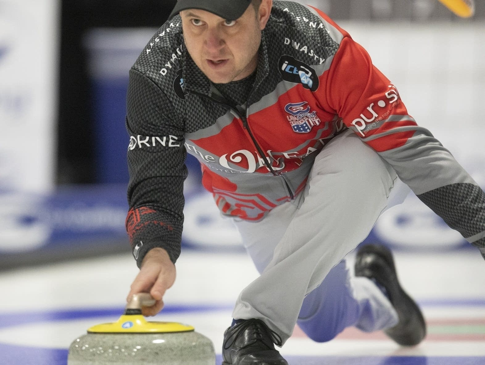 John Shuster delivers a stone