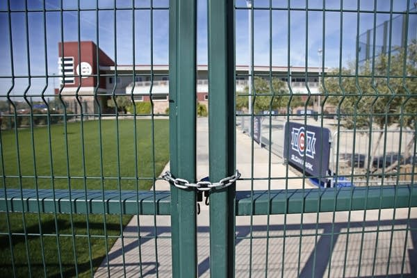 A gate at the Chicago Cubs practice facility in Arizona is closed