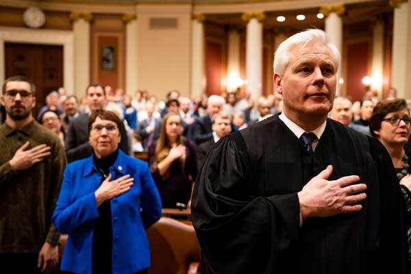 Justice Paul Thissen says the pledge of allegiance.
