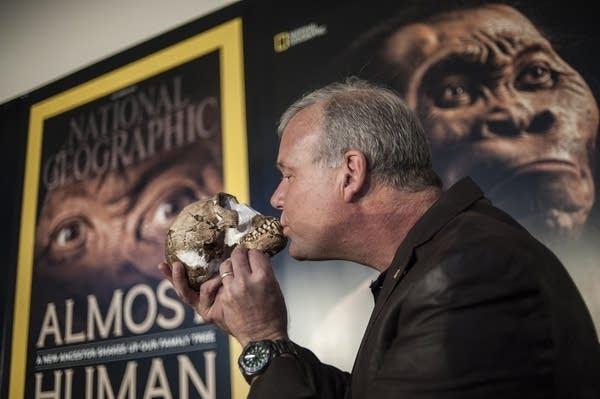 Prof. Lee Berger kisses Homo naledi skull