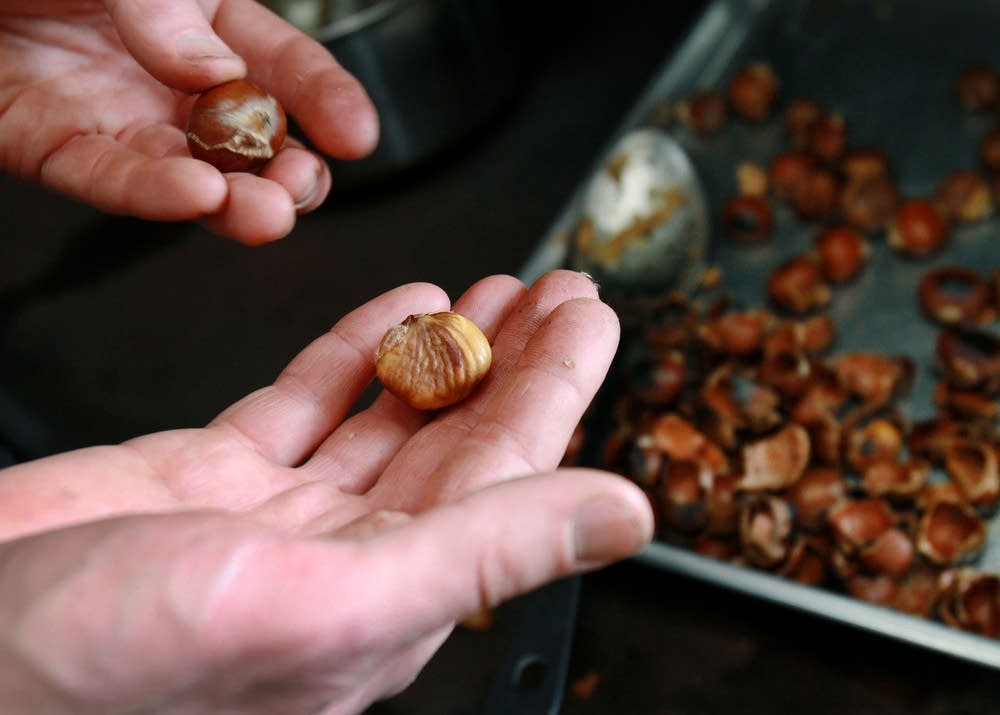A peeled, roasted chestnut fresh out of the oven.
