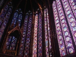 Light passes through the stained glass windows of Sainte-Chapelle.