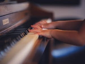 A child plays piano.