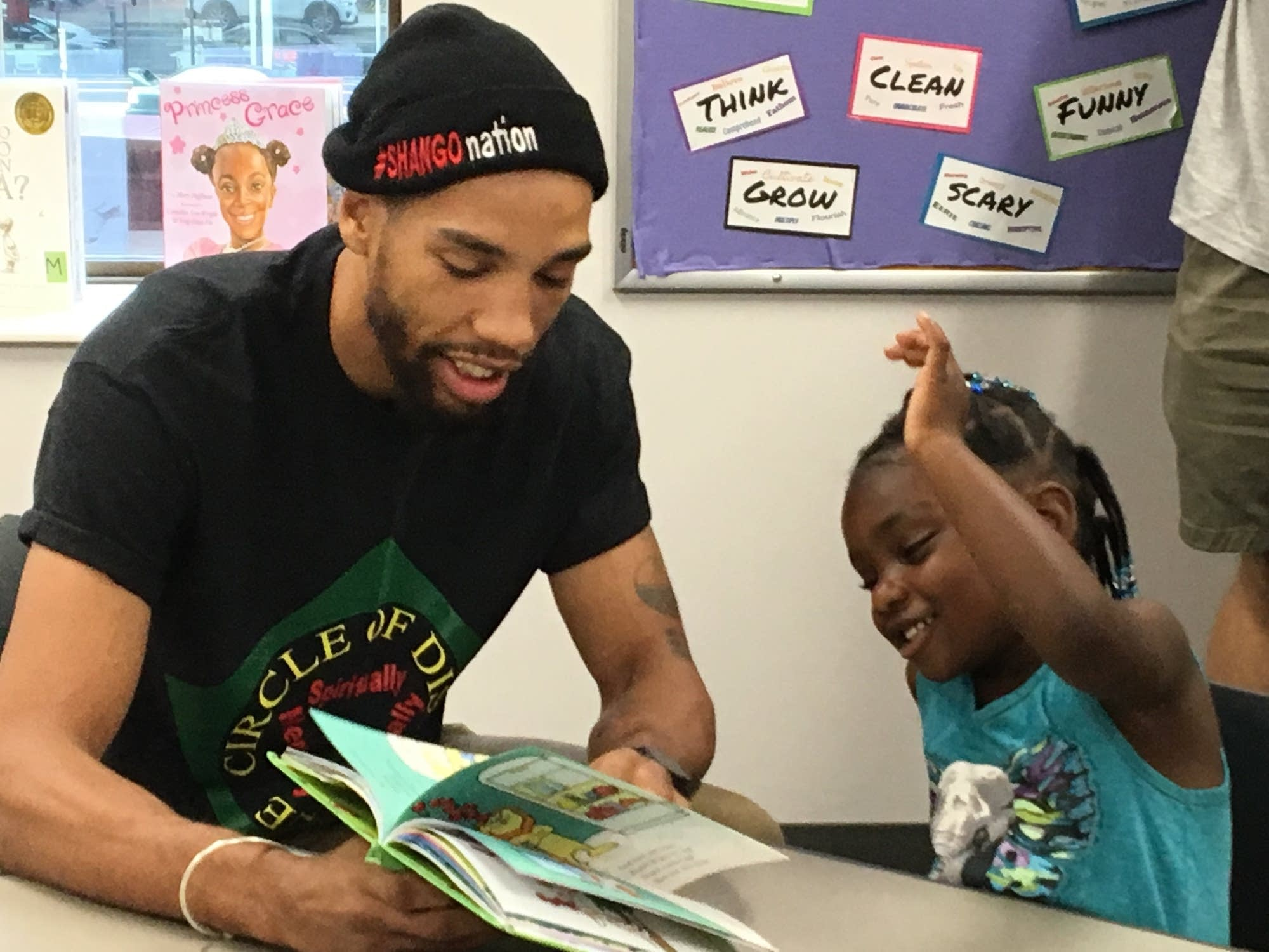 Jamal James reads to a child.