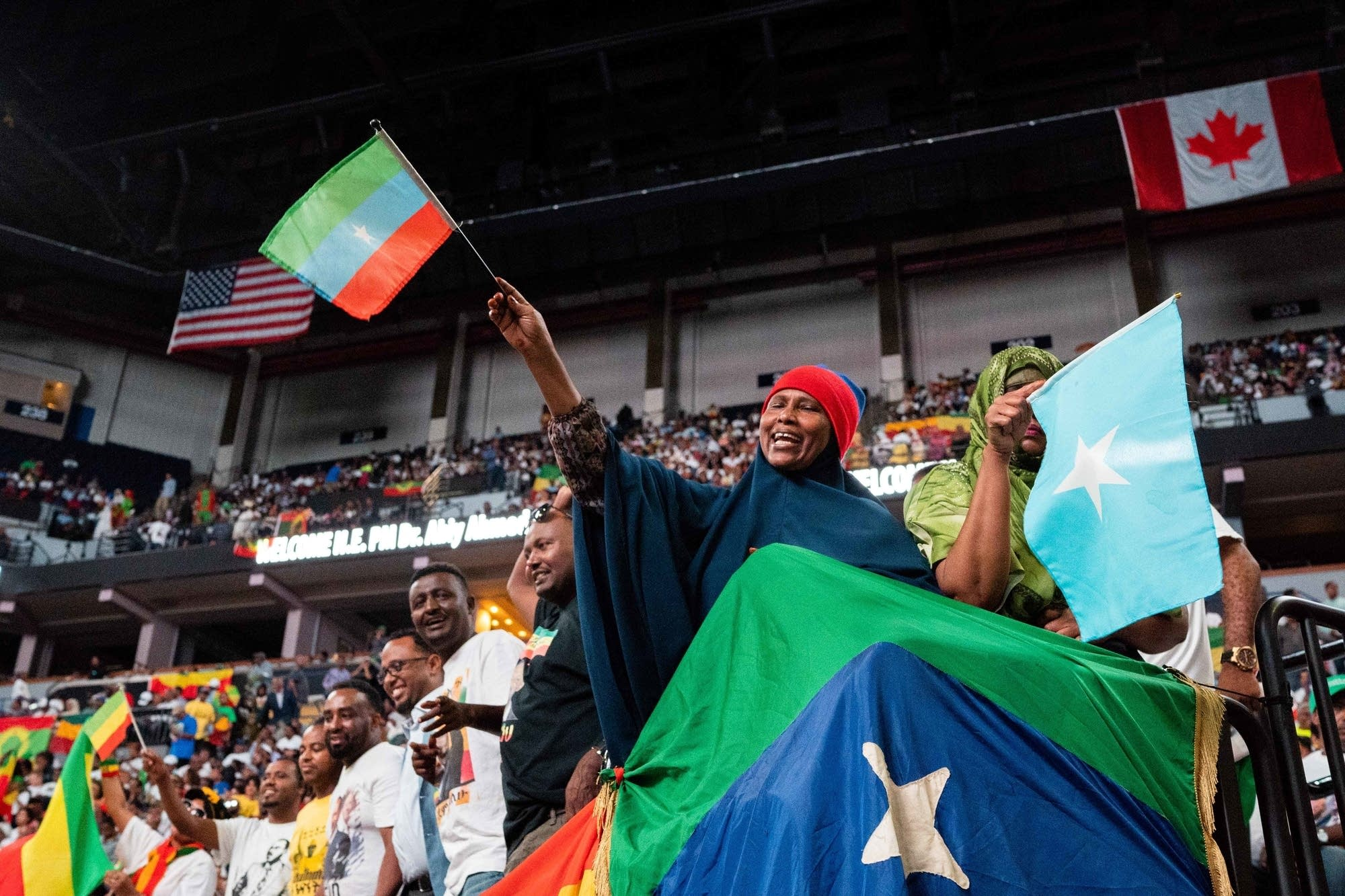 Attendees wave flags before Abiy Ahmed's speech.