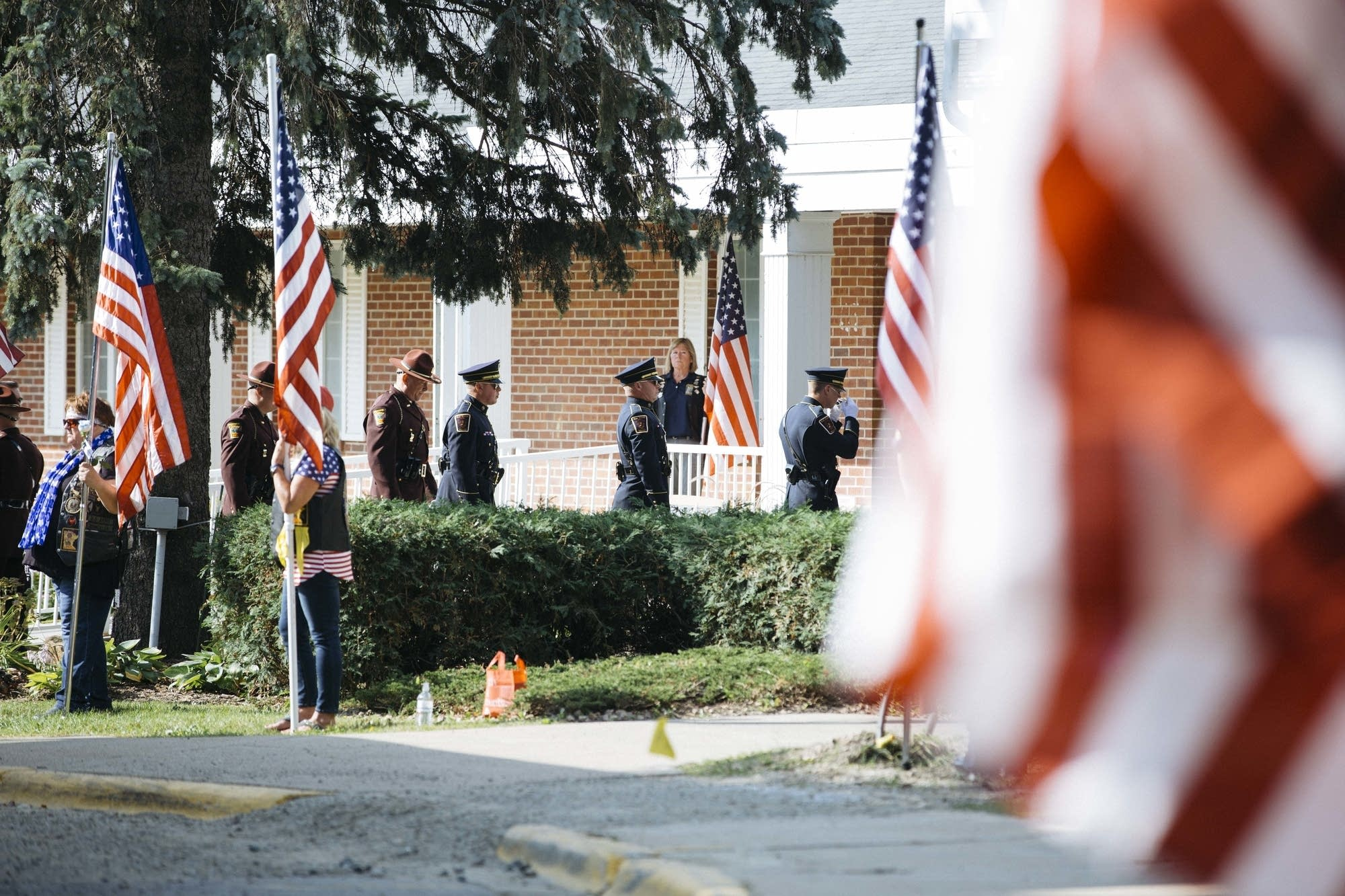 Police officers enter Wayzata Free Church before the funeral.