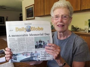 Rosemary LeTendre holds a copy of the last daily edition of the Globe.