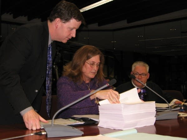 Elections officials go through results