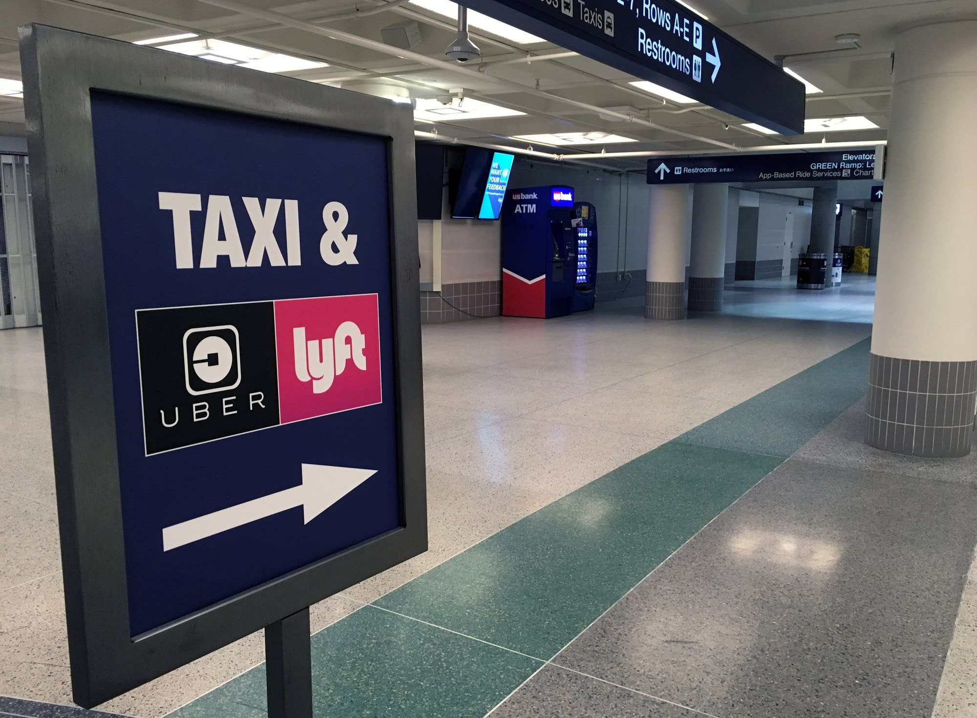 Signs at MSP terminal direct people to both taxis and ride shares.
