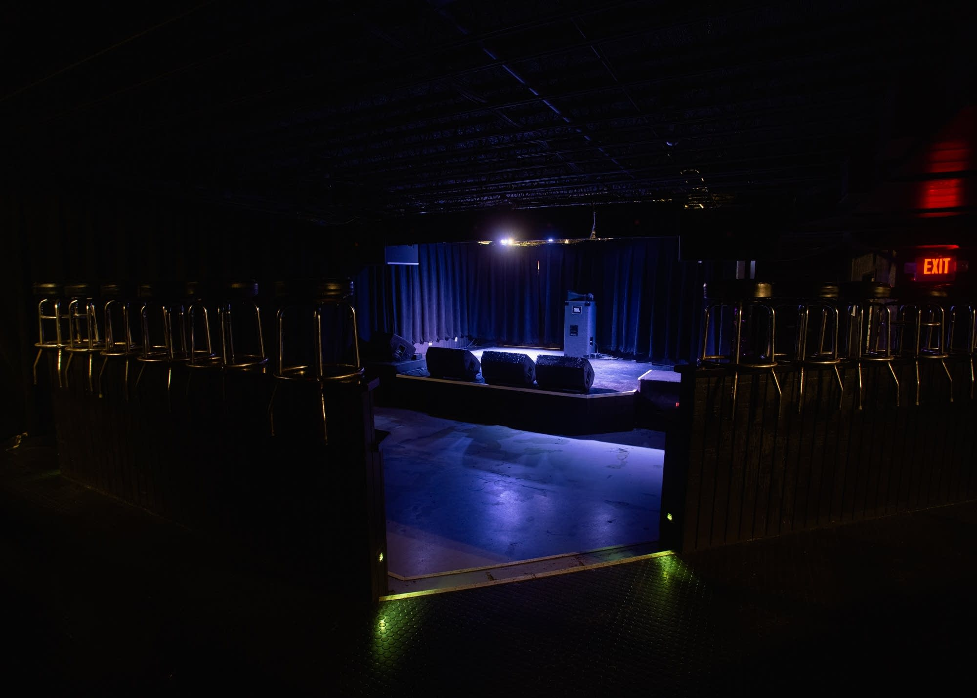 The interior of the 7th St Entry. The empty stage is lit purple.