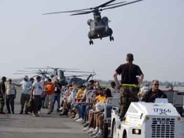 Survivors of Katrina arrive at New Orleans Airport